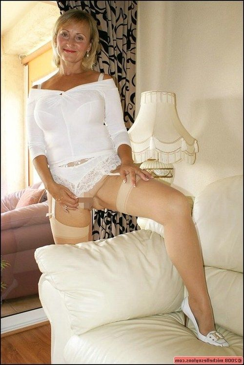 Old lady in white  and underware amplifying and playing with dick on the sofa