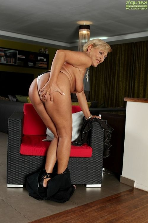 Elderly Andrea is looking hot in brown nightie and high heels