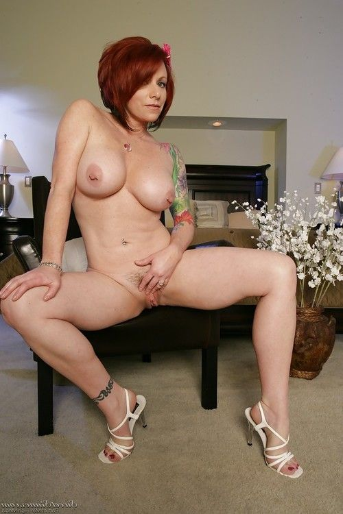 Tattooed placid lady with largest jugs Kylie Ireland delicious off her underware