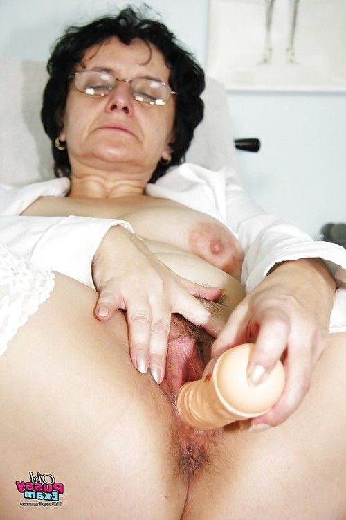 Sexual established in glasses wanking her snatch with a sextoy