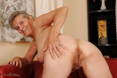 Lusty aged with giant saggy jugs undressing and exposing her love-cage