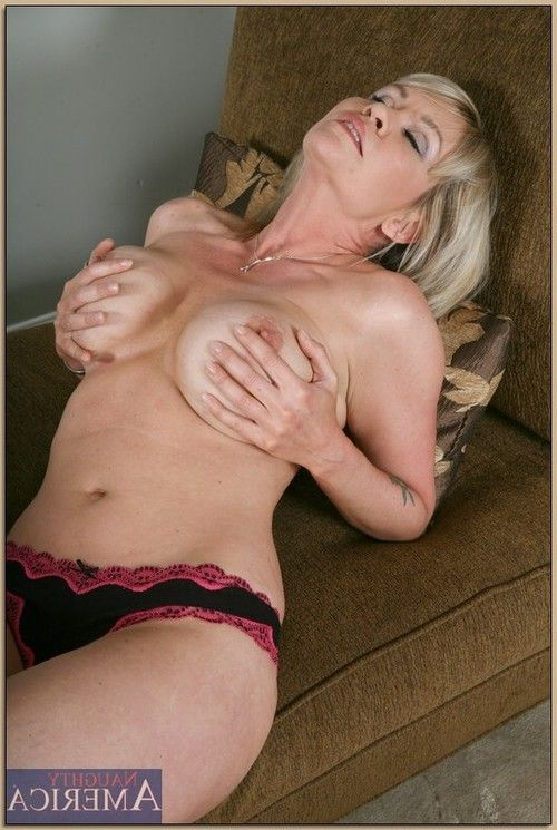 Ripe blond Bridgette Monroe caressing milk sacks and jerking off