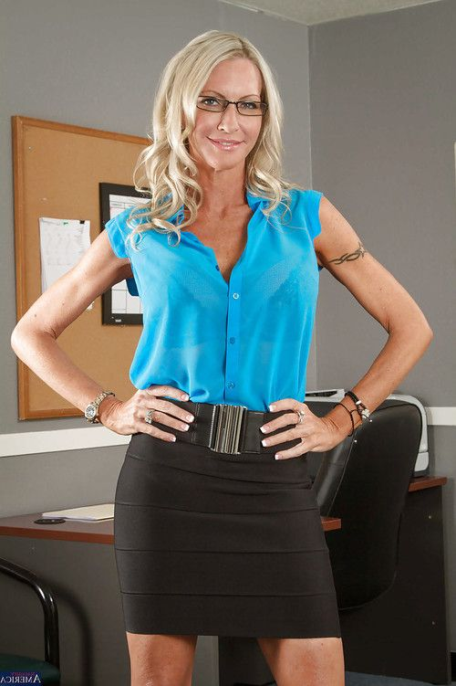 Emma Starr takes off her clothing simply to pose without clothes in the office