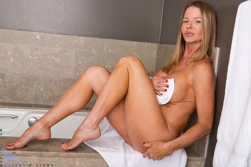 Amber michaels peels off her towel to show her vast whoppers and