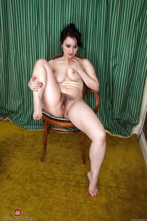 Experienced brunette hair lady baring colossal breasts sooner than unveiling hirsute bawdy cleft