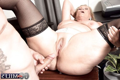 Chubby over 60 golden-haired older Alice engulfing giant snake in nylons