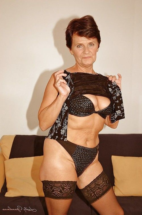 Short haired established in  striptease off her costume and underware