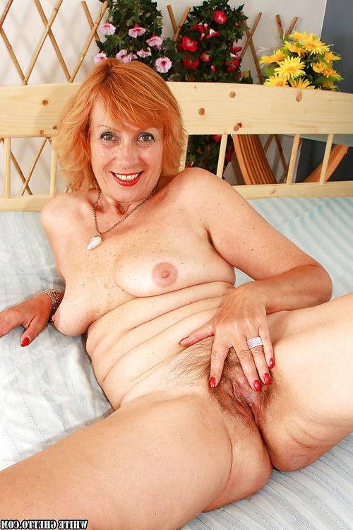 Sexually aroused aged with furry love-cage erotic dancing and swelling her legs