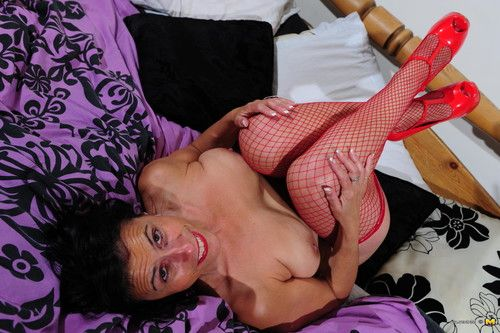 Sexual housewife playing alone on her daybed