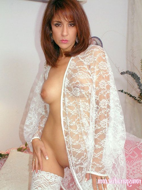Alluring mama in white lacy underware and  disrobes in her couch