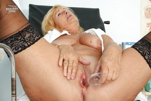 Slimy elderly in nylon nylons toying her bawdy cleft by sex tool and wand