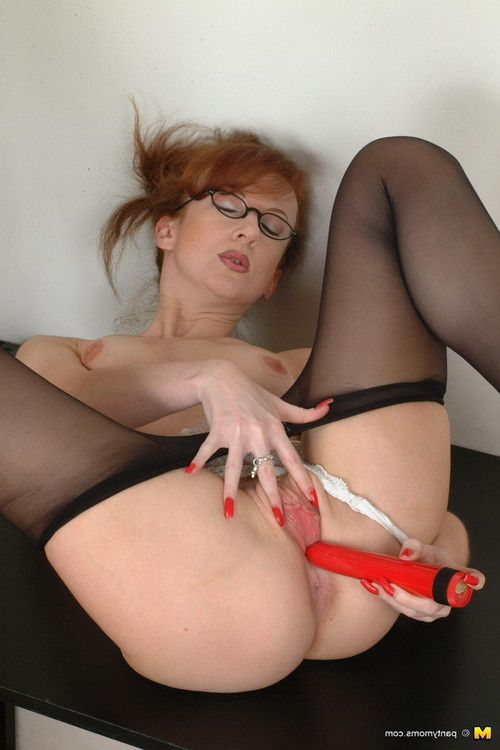 Redhead full-grown secretary amplifying her sticky a-hole in ebony pantyhos