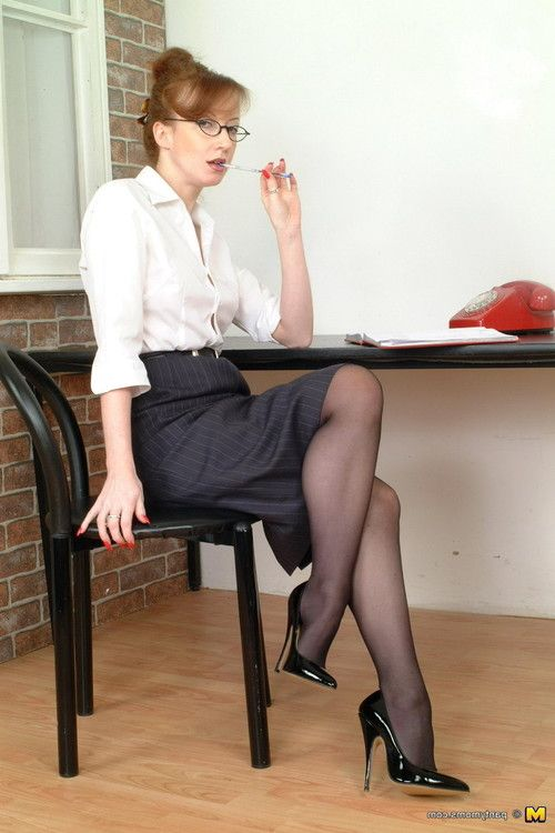 Redhead full-grown secretary amplifying her sticky a-hole in ebony pantyhos