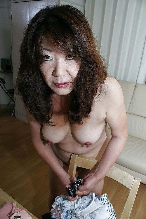 Eastern grandpa Michiko Okawa undressing and exposing her shaggy vagina in close up