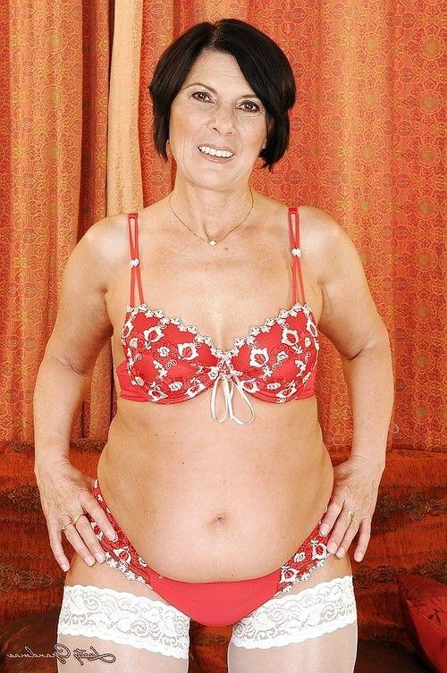 Fatty older in white  slipping off her lacy underware