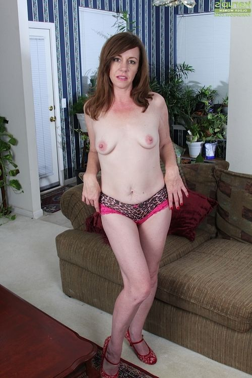 Ripened woman Joanie Bishop removes underclothing and high heels during striptease