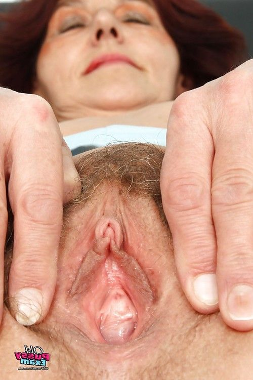 Lascivious ripened showing her flaccid wobblers and playing with dick her furry slit