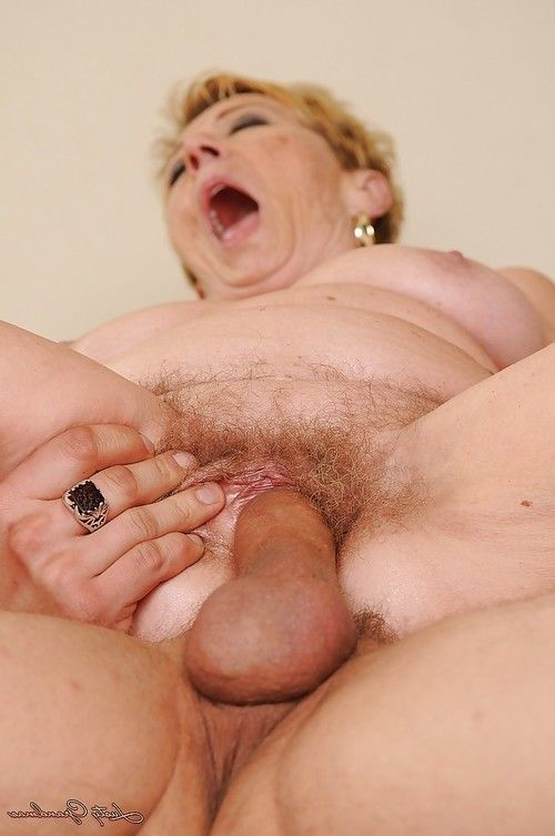 Sexually aroused grown up gains her furry pussy cocked up and takes a spunk flow in her maw