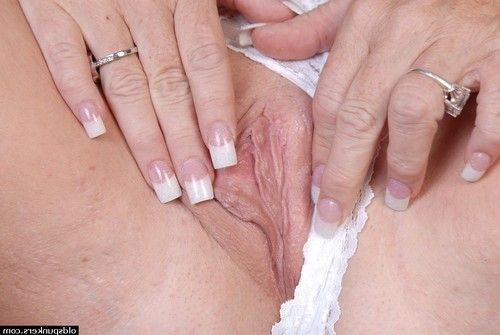 Nasty older Debella shows off her saggy love bubbles in the changing room