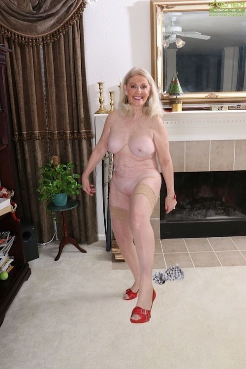 Stocking garbed mature blond Judy Belkins amplifying skinhead cage of love in nylons
