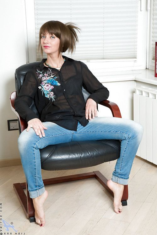 Barefoot grown dark hair in jeans baring miniscule love bubbles even as undressing