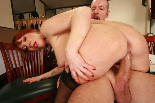 Titsy milf redhead takes a large jock on the job