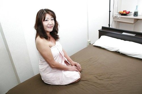 Saucy Chinese established Michiko Okawa toying her unshaved slit later on shower-room
