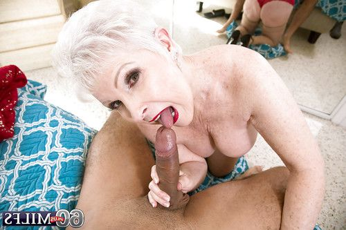 Tube attired mature Jewel giving oral play prior to bald twat very