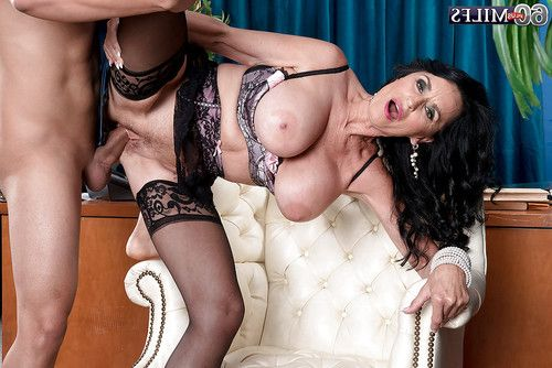 Dark hair cougar Rita Daniels baring weighty ripened front bumpers ahead of hardcore banging