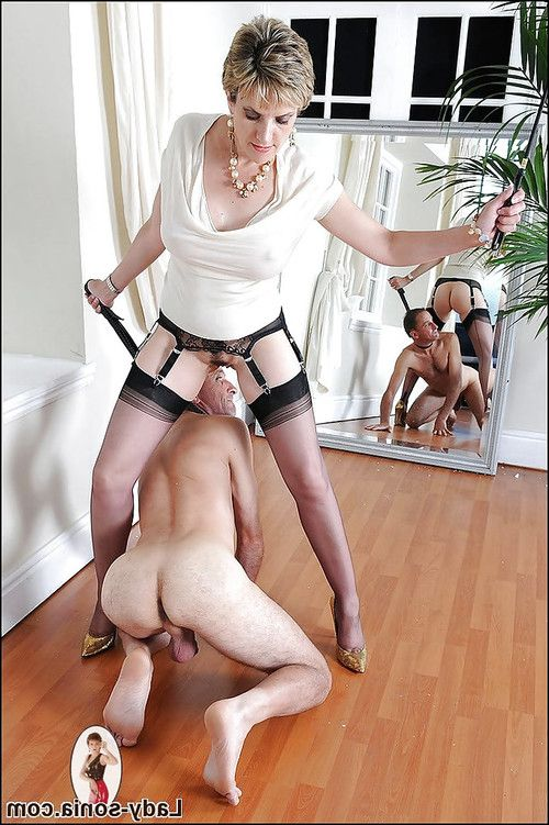 Grown femdom whips her manslave and tortures him with her high heel shoes