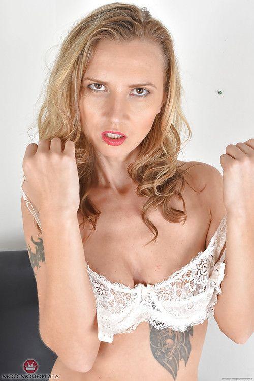 Full-grown Euro lady Alina Fancy flaunting tattoos and piercings in underware
