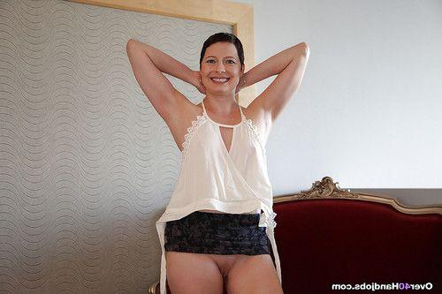 Short haired dressed full-grown lady hiking short skirt for bald uterus amplifying
