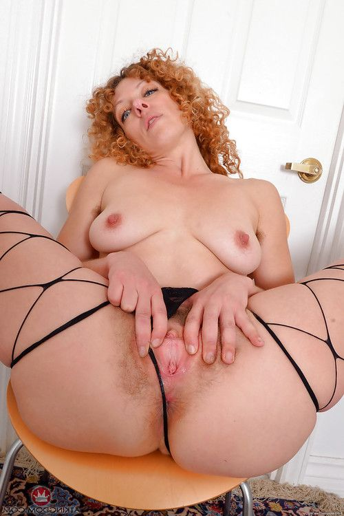 Mellow redhead with fantabulous legs freeing bushy bawdy cleft from underwear