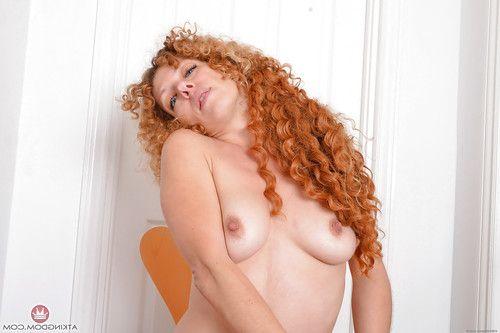 Mellow redhead with fantabulous legs freeing bushy bawdy cleft from underwear