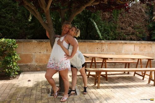 2 bawdy german housewife making out on vacation