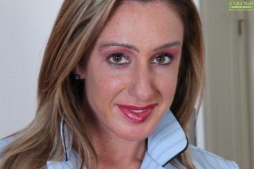 Ripe woman Ashley Brooke sliding underclothing over shiny on top vagina