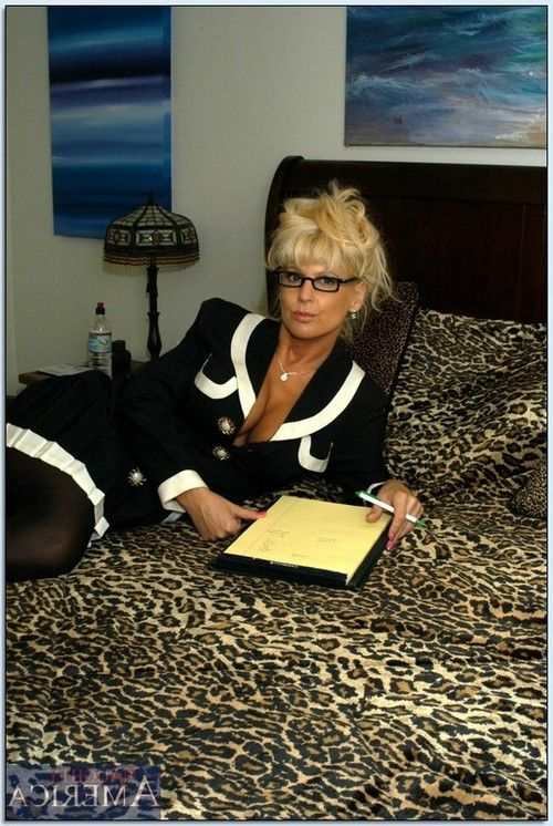 Full-grown advisor in glasses Vicki Vogue playing with a cock-sock penis