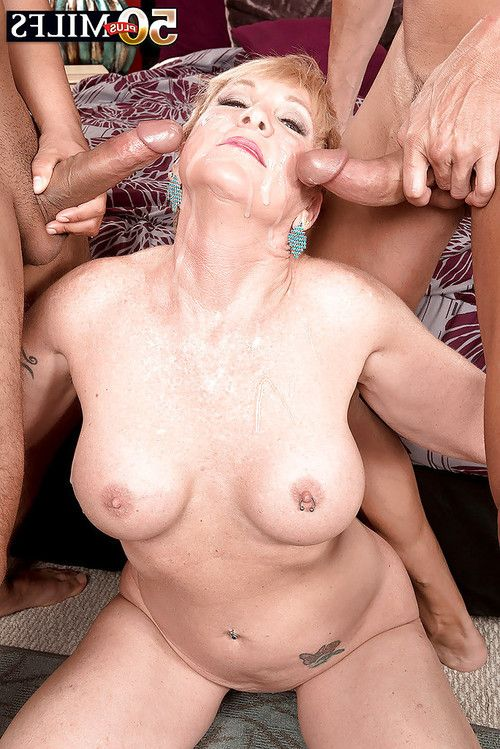 Short haired lady over Fifty Bombita Ray giving blowjobs in MMF MMF
