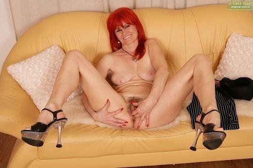 Granny redhead Amanda Rose undressing for masturbation of curly uterus