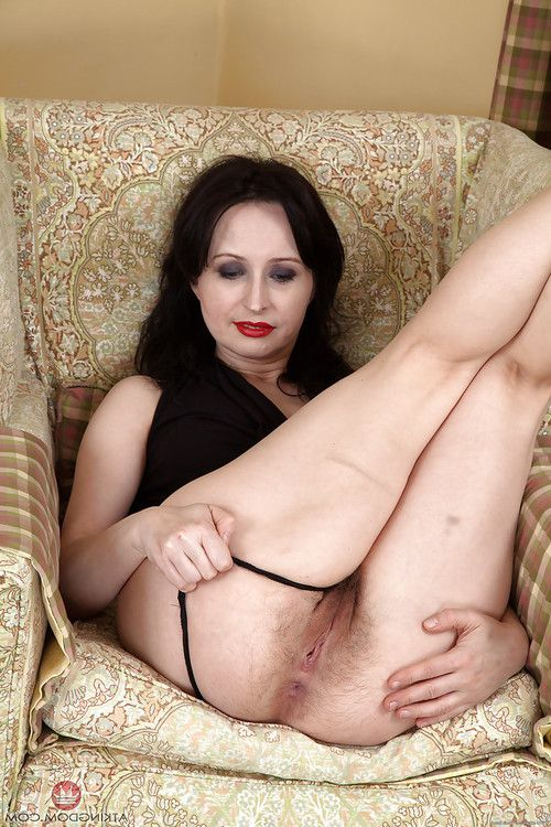 Established dark hair lady in high heels revealing perfectly hirsute cage of love