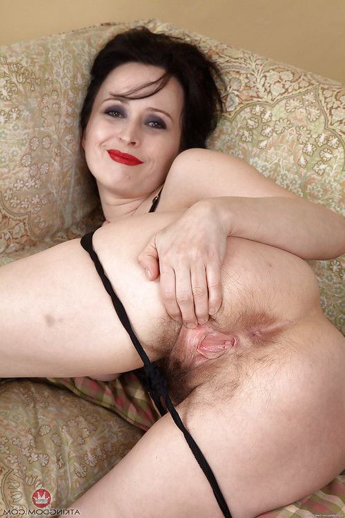 Established dark hair lady in high heels revealing perfectly hirsute cage of love