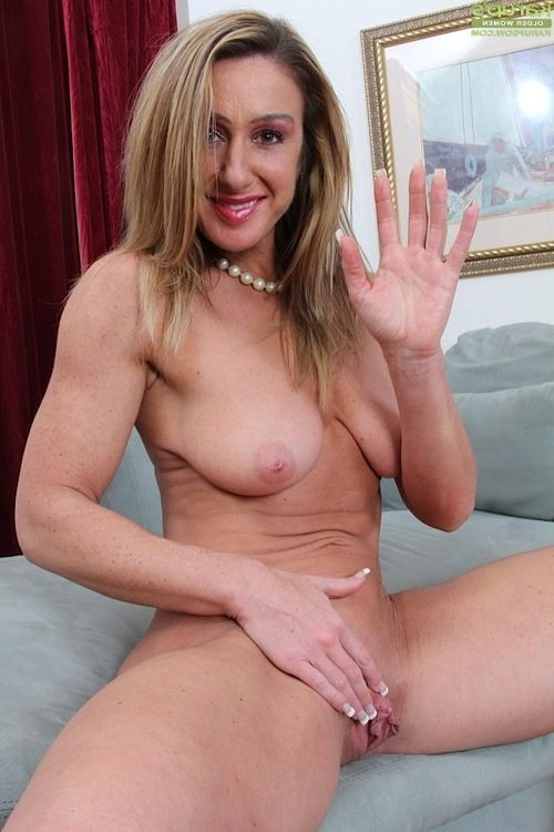 Aged lady Ashley Brooke undressing for baring of saggy bra buddies and shaved muff