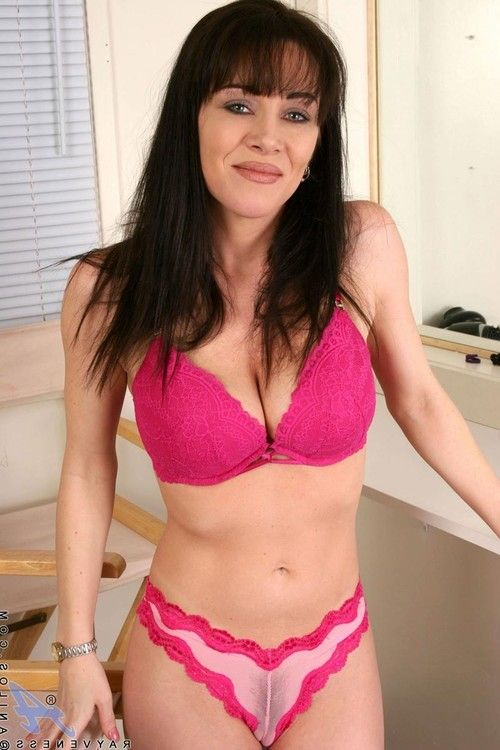 Classic milf lady lifts up her clothing to show her sheer charming rosy panty