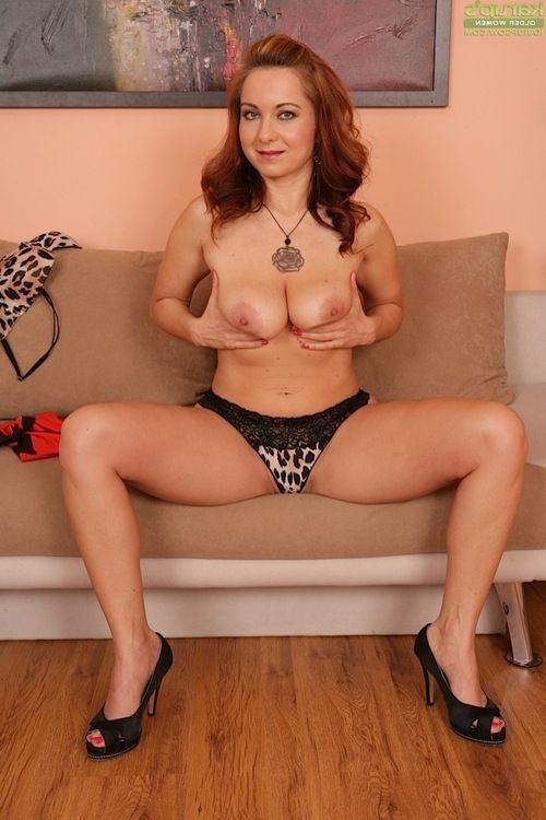 Leggy seasoned lady Jessica Red exposing vast meatballs and excellent anus in high heels