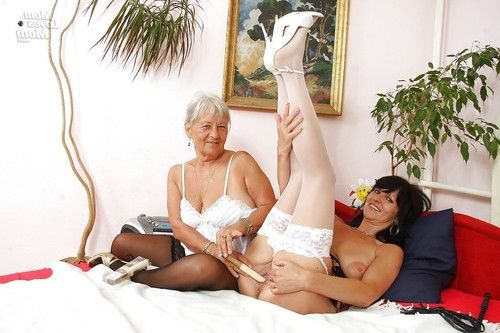 Raunchy mellow lady has a girl-on-girl love making act with grown up in lacy underclothes