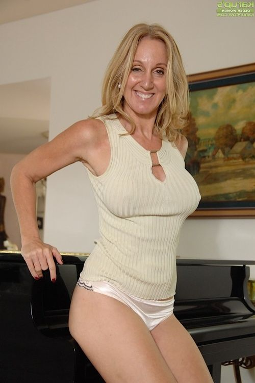 Fairy milf takes off her underwear whilst playing with her immense love melons