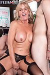 Mature whore attracted to being dug by 2 sticks