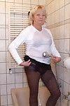 Blond housewife killing a decadent washroom
