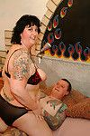 Calm tatooed pair having red sweaty firey love making act