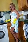 Ripened blond lady Cathy Oakley baring her milk cans in kitchen